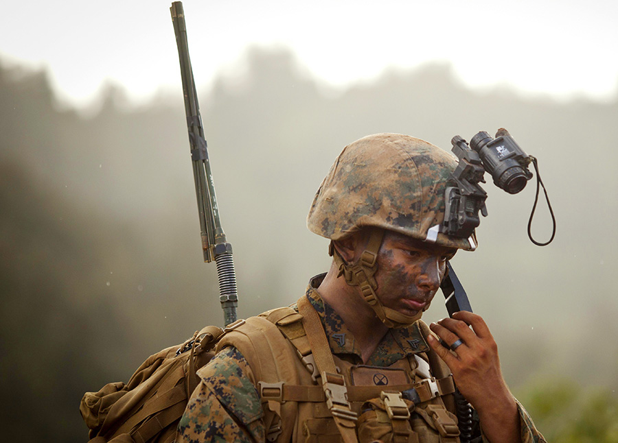 U.S. Marine Corps Cpl. Christopher Griffith a squad leader with Lima Company, 3rd Battalion, 4th Marine Regiment, conducts a radio check during the Advanced Infantry Course at Kahuku Training Area, Hawaii